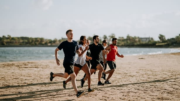 Men and Women Running on beach